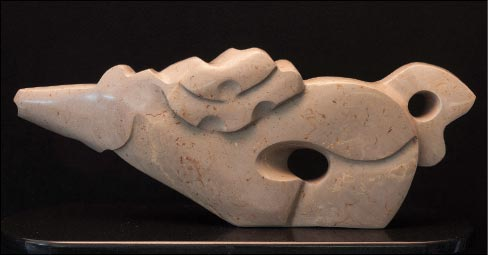 """Hot Brown,"" carved from Kentucky limestone. Not a standard stone used for sculpture, Julie says that she has discovered that Kentucky limestone polishes beautifully, and often reveals hidden veins and streaks of color that give her new pieces great texture and visual interest."