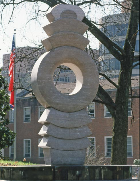 """Terra"" was commissioned by the University of Tennessee to celebrate their Bi-centennial, and was installed in 1996. The marble was cut for Conn in Friendsville, at Tennessee Marble. Conn transported the three large pieces to a monument company in Cleveland, Ohio where they were roughed out on a large saw, and where the center circle was also cut out. ""I drove the pieces back to my studio where I contoured the stones, textured, shaped and polished."" The twelve-foot diameter granite base was fabricated in Georgia at one of the granite companies."
