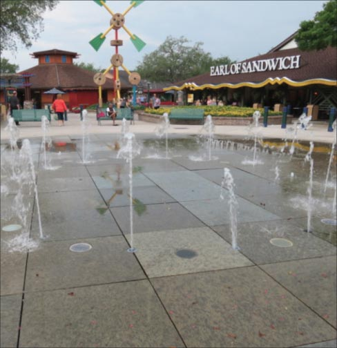 "Repaired fountain at a Disney Theme park. The Green Granite squares that make up the surface are 6mm thick x 3 feet square. ""They're big pieces of granite, but people keep driving over them, and when they do, they crack the stones. Then we get the call."""
