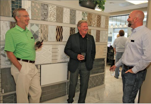 AG&M employees Tim Reid, CFO, Greg Strom, National Marketing Manager and Jesse Bogan, Operations Director enjoying the grand opening reception in the gorgeous AG&M Anaheim showroom.