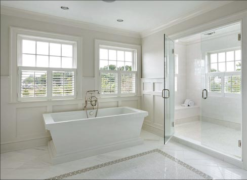From the over-sized shower and soaker tub to the large-format Calacatta floor tiles with a glass inlay carpet, classic perfection and understated elegance is captured in the simple, clean beauty of white marble.