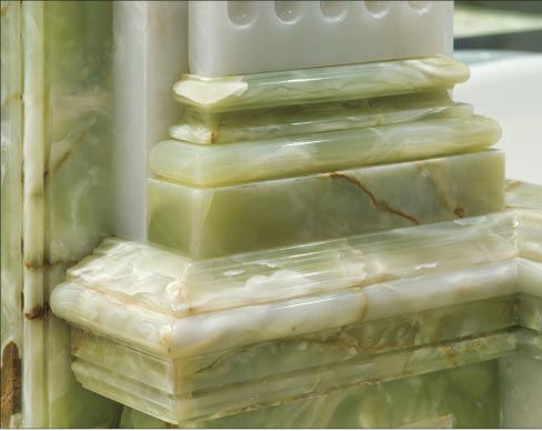 Column and trim detail from an opulent master bath lavishly decorated with Green and White onyx.