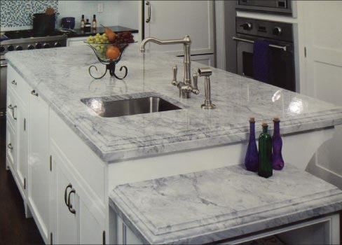 Laminated Newport White Quartzite island with matching wine cooler table top for a custom residence in New York.