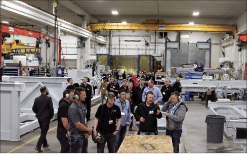 Attendees tour Park Industries at a two-day Digital Stoneworking Expo hosted by Park at its St. Cloud, MN facility.