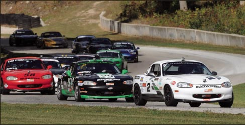 Berry (number 29, black and green) battles  to overtake lead car at Road America race, Elkhart Lake, Wisconsin.