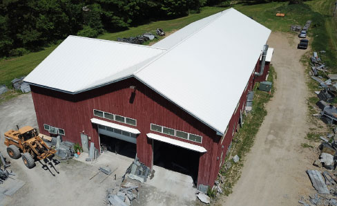 Ashfield Stone's 8,500 square foot shop is built on ten acres, and updated six years ago when the Pratts needed more production space. Heat for the building is from an outdoor, wood-burning furnace and fed with local wood, most likely logged by Jerry Pratt.