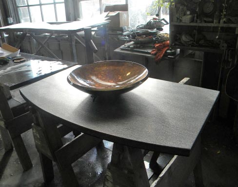 This vanity top fabricated in the Ashfield Stone shop shows off the distinctive grain found in schist, and is designed for a vessel sink