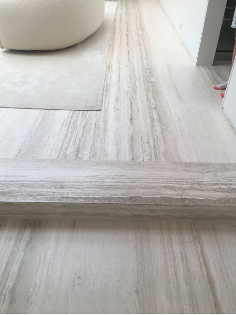 Vein cut Travertine slabs as flooring: what you see is what you get — including natural imperfections.