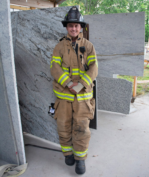 Josh Stafford balances the dual roles of a first responder fireman for the Chatsworth, GA fire department and the granite shop his father started in 2005, Superior Stone Countertops.