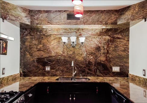 "Rain Forest Green marble kitchen includes a mitered/continuous pattern soffit to hide the heating duct. Sherpa Stone's client ""hated the drywall soffit,"" and asked if Sherpa Stone could do something to hide it, and create a dramatic effect."