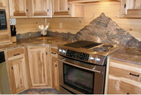 This creative twist on kitchen countertops features 3cm Juperana Crema Bordeaux granite with a chiseled backsplash designed to create a running mountain range.