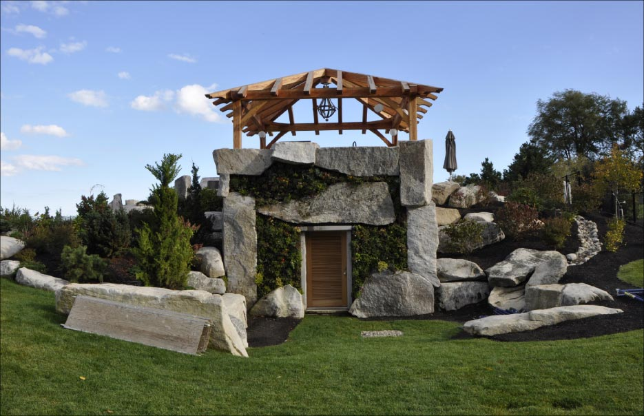 Monolithic construction and landscaping, this bunker for a pool and hot tub in Cape Elizabeth, Maine is made of local granite and was quite a challenge for Dan and crew. Photo: Jill T. Greenlaw