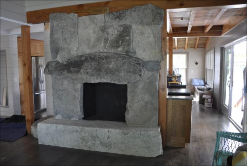 Form meets function and utilitarian art is the result of this fireplace that embellishes this Edgecomb, Maine residence. Photo: Jill T. Greenlaw