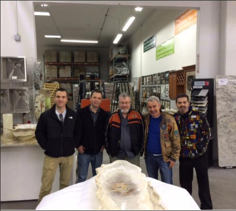 Fred Hueston and 2017 attendees visit a shop to study fabrication issues.