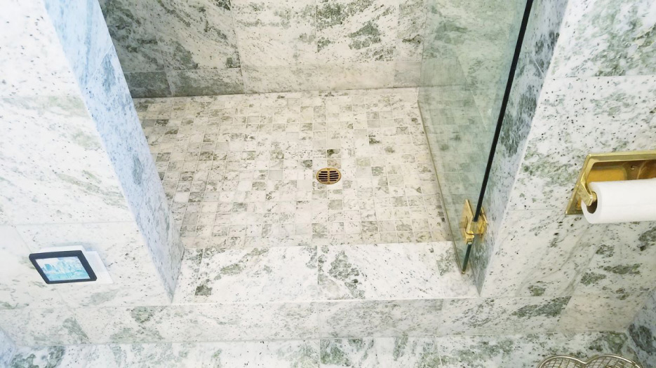 This 20-year-old marble shower had no water discoloration problems due to the dry-pack mortar bed and traditional water-in/water-out installation system.