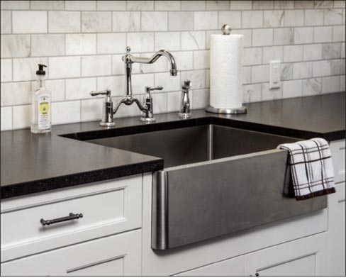 A Stainless Steel Apron Sink Will Complement Cambrian Black Granite  Countertops.