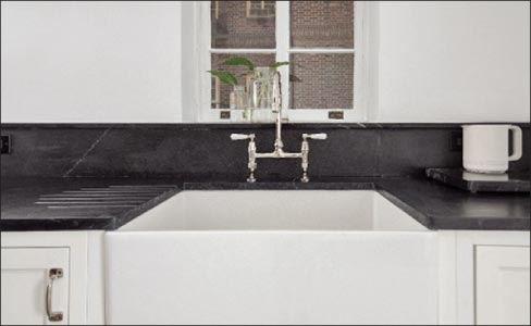 This White Cast Iron Apron Sink Is Paired With Oiled Soapstone Countertops  Featuring A Beautifully Functional