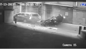 Surveillance video from an Austin, Texas parking garage shows a car dropping out of the sky and crashing in an alley.