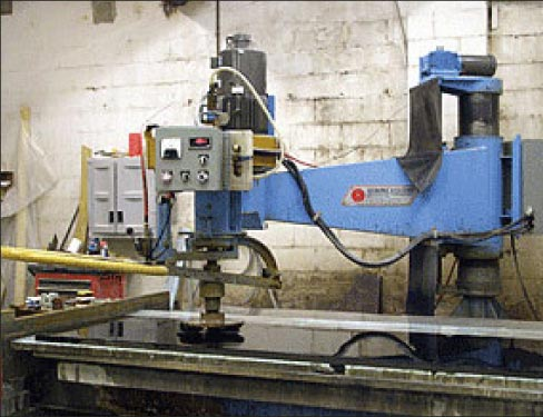 A radial arm polisher is an important machine in many fabrication shops. Here, an old reliable Sawing Systems machine restores a slab back to a factory polish.