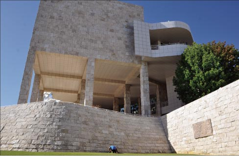 The Getty Center is clad with travertine. This photo shows one of the feature stones (far right), highlighted to show intriguing natural textures of the stone. Photo by 'Ted,' reused via Creative Commons license. Below: Fossilized leaves in a Getty Center feature stone