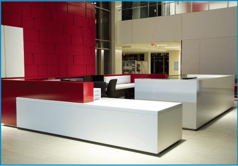 Quartz countertops and divider walls for a modern corporate lobby.