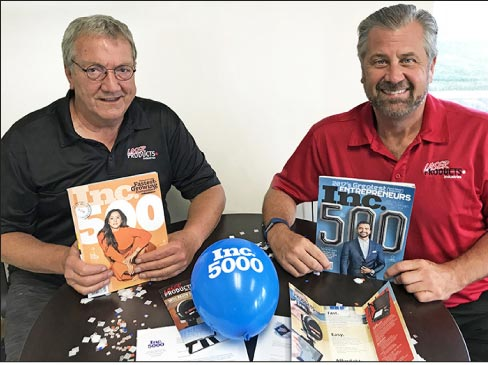 Laser Products Industries CEO and founder Dan Louis (left) and President Rich Katzmann (right) celebrate the company's inclusion in the Inc. 5000 for the second consecutive year.