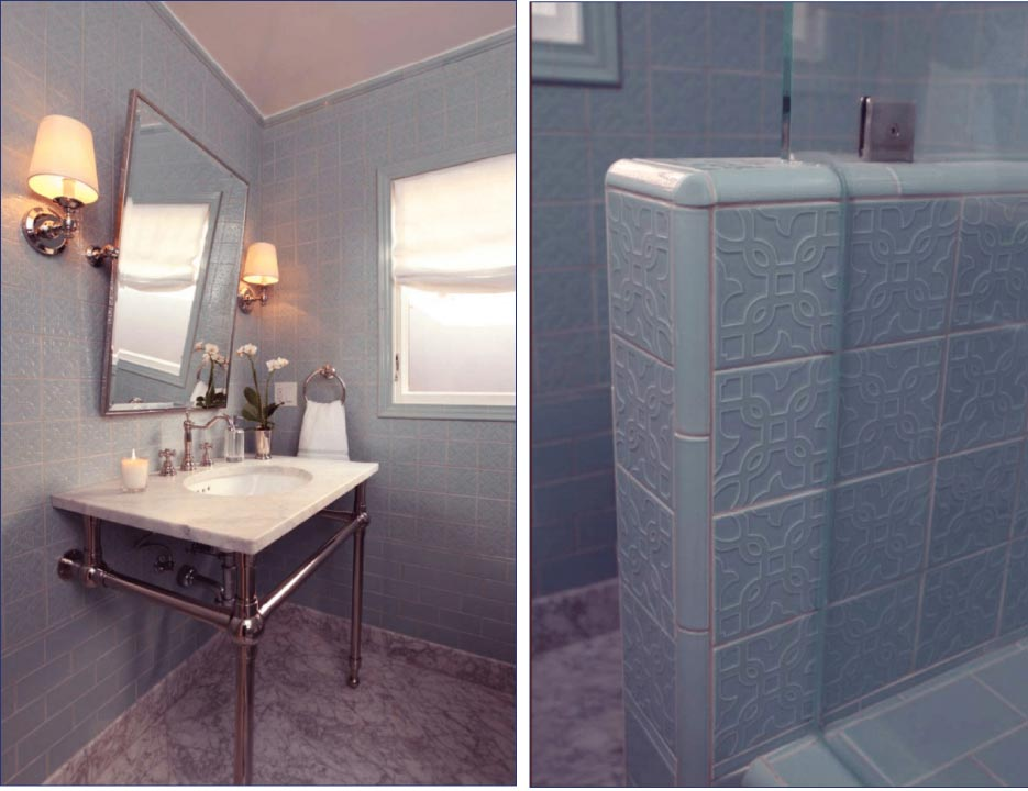 The drama of this gorgeous powder room is the floor-to-ceiling colored decorative tile. A simple subway tile begins at the bottom giving way to the embossed 4 x 4 inch tiles which are capped off at the ceiling by a decorative liner and cornice piece. Carrara vanity top and floor provide a nice compliment to blue tile.