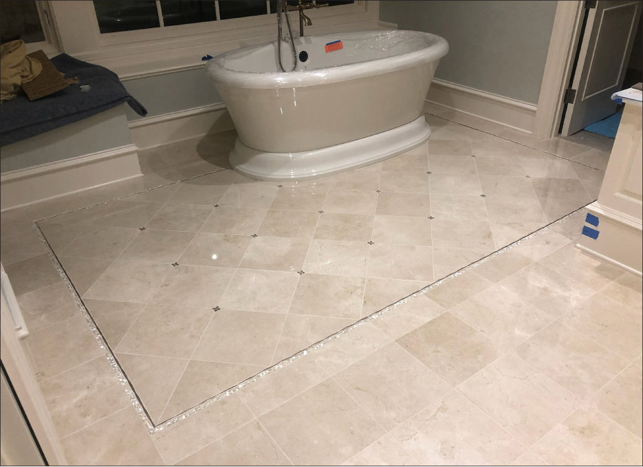 In this master bath, Crema Marfil was installed over double-layer plywood per industry standards. The floor was flattened to the required plane with a suitable fiber-reinforced, self-leveling underlayment before the stone was installed. All resin-backed stone was primed with a single component primer suitable for wet areas and installed with minimum 95 percent mortar coverage per industry standards. Photos (2) courtesy of  Stoneman Construction LLC,  Portland, Oregon.