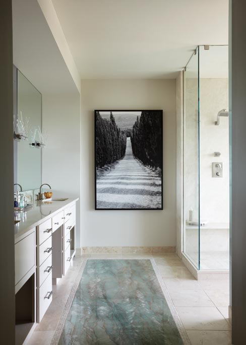 "According to Jeremy Werthan, ""The slab for this Gaya Green Quartzite Floor Inlay had to be craned in through the Penthouse window. We used Crema Marfil everywhere else on this residential bathroom."" Design by Landy Gardner Interiors.  Photography by Matt Harrington"