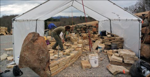 Construction started with the drystone walls. Mason Gary Wilson works beneath the winter shelter. Masons Fred Lashley and Jonathan Frederick (not pictured) round out the Hammerhead crew and contributed their talents to completing the Scared Circle.