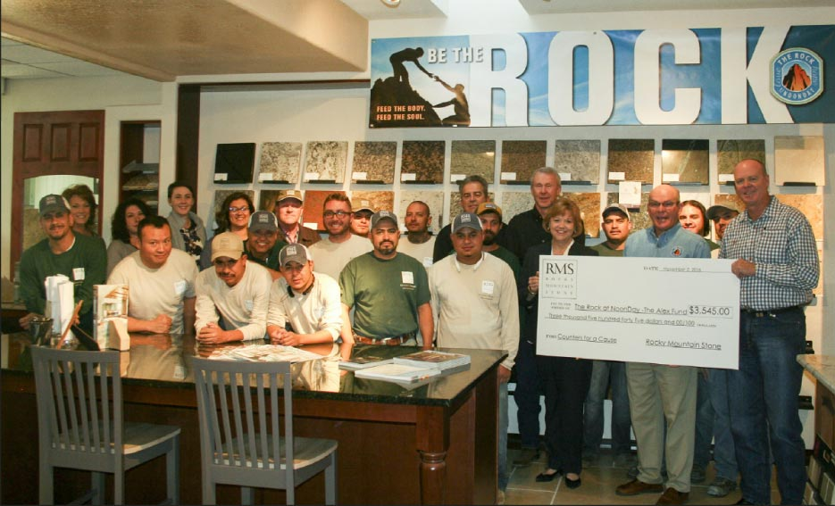 The Rocky Mountain Stone team presents a check to The Rock at Noonday – the Alex Fund, an Albuquerque, New Mexico charity that provides food for the homeless and hungry, five days a week.
