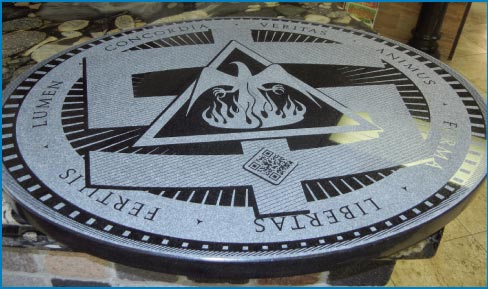 This laser-etched Black granite medallion was commissioned for a UNM student art exhibit.