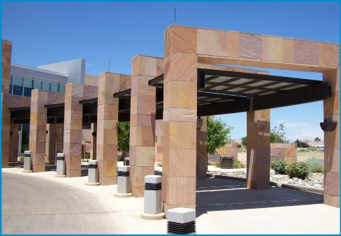 A 2005 cladding  job for the PMG High Resort office building has about 15,000 square feet of mechanically anchored Indian High Desert Red Sandstone.