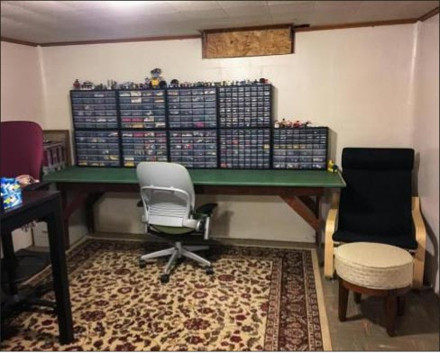 Richard's basement Lego workshop, where some 7,000 Lego pieces were stolen while the family slept, like some Hollywood heist movie.