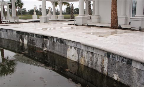 Adhesive failure in the Limestone coping of a Lumberton pool, visited by Hurricane Katrina. This is one I'm glad I didn't fall into!