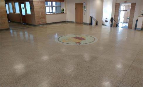 The first step toward restoring the terrazzo floors and travertine stairs (and walls) was removing over 35 years' worth of wax and floor finish build-up.
