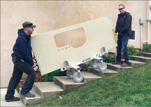 The Omni Cubed Pro-Cart AT2 and a pair of Aqua-Jaws give installers the ability (and leverage) to maneuver heavy countertops up stairs and across thresholds – and also prevent injury.