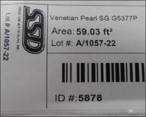 Inventory bar code sample shows square feet, location and ID number for this Venetian Pearl slab.