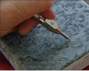 Alpine soapstone contains talc, easily scratched with a number 2 pick.