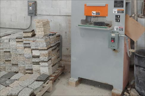 Stacks of granite remnants in the form of pavers and firepit sections await a more useful future instead of being discarded in a landfill – all part of Gecko's emphasis on running a green, environmentally conscious shop.