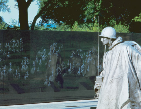 Korean War memorial: The design is a formation of four 16-foot tall granite clad columns surrounded by four granite walls – each column representing one year of the Korean War.  Thermal polished Academy Black granite was chosen to create a clear background for the memorial's artwork, which was transferred and carved into the stone.  Philadelphia, PA.