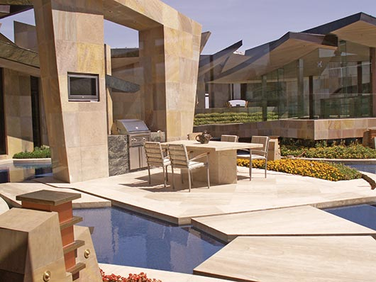 Private residence in Southwestern USA.  French Beaumaniere limestone was adhered on the deck and Panther Sandstone was mechanically attached to the exterior walls. Bisazza Glass Tile was used in the water features. CTaSC provided installation specs and quality control services for the installation of these products.