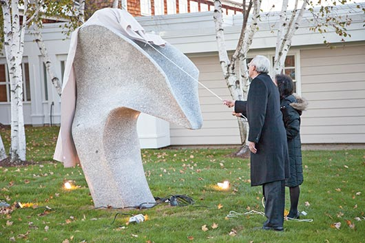 "Now the cornerstone of Acadia Hospital, Maine artist Andreas von Huene's ""Zephyr"" is unveiled by Hospital President and CEO Dan Coffey and Max Kagan Family Foundation representative Leslie Kagan."