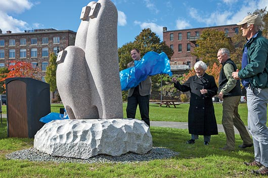 "Japanese artist Koichi Ogino's ""Camel Country"" is unveiled by Bangor City Council Chairman Cary Weston and John Rohman at the Bangor Waterfront."
