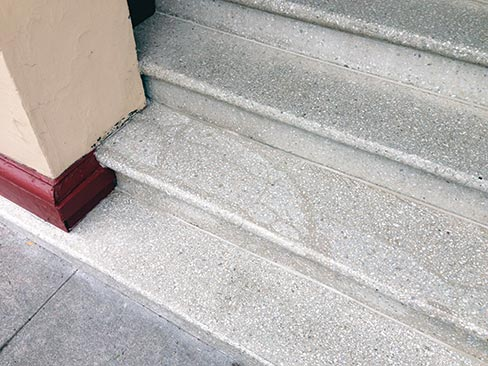 (after) Repair and restored 80-year-old terrazzo steps in a historic apartment building in Portland. Wiley repaired with epoxy/terrazzo, then cleaned and polished it all.