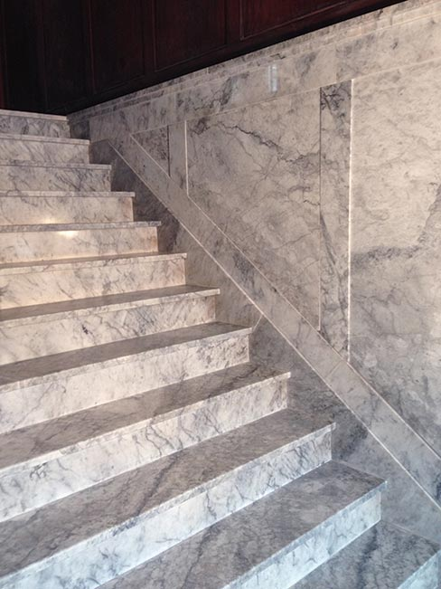 (after) Historic Alaskan Tokeen marble entry steps in another stately, old apartment building in Portland.  Common to old construction in Portland,  Wiley has repaired several steps similar to this in the area.