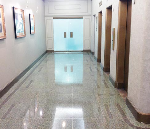 (After) This floor had a lot of pitting that they epoxy filled before honing and polishing. This is a polished finished, not waxed.