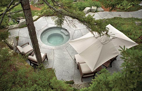 "A spa work of art that sits on the coast of Maine, built using two 50,000 pound blocks of Freshwater Pearl Granite. ""We are known for using rather large stones but they are getting hard to find these days,"" said Jeff Gammelin, Owner, Freshwater Stone, ""so what we do is take the weathered faces of the quarry ledges and blocks we cut and saw them off at 6 to 8 inches thick and most times end up with a beautiful 5-inch to 8-inch thick piece of granite with moss and lichen on it and use them in our residential and commercial work."""