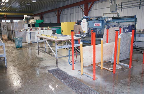 Seen at right in the foreground, Freshwater Stone's Thibaut T-102 radial arm polisher. At left in the background is a Prussiani CNC, which handles much of the shaping and polishing of the company's slab work.