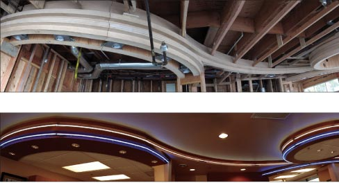 "This curved soffit was traced and a template created to fabricate a matching desk area, below. ""The company that did the lighting didn't have any way of measuring the soffit once it was raised to the ceiling. Luckily the countertop fabricator was there at the exact same time and was able to help them out."""